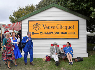 Motoring enthusiasts attend the Goodwood Revival, a three day classic car racing festival celebrating the mid-twentieth century heyday of the sport, at Goodwood in southern Britain