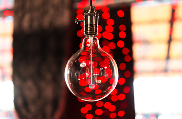 Closeup of electric decorative lamp against red background