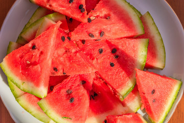 Fresh sliced watermelon on a plate close-up - top view
