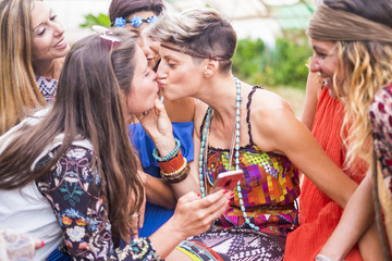 love relationship and friendship with two caucasian beautiful girls kissing eachother on the lips with love and gay lesbian way. diversity and sexual euqality concept for free alternative ladies