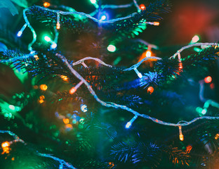 festive background multicolored christmas lights on new year tree