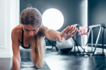 Young beautiful woman in sportswear doing stretching