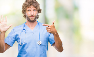 Handsome hispanic surgeon doctor man over isolated background showing and pointing up with fingers number seven while smiling confident and happy.