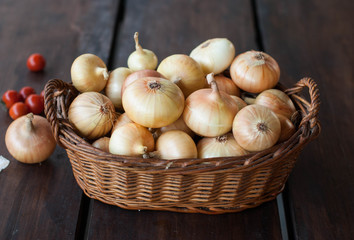 onion in a basket on a dark table