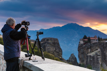 Man take photo from Meteora monastery