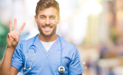Young handsome doctor surgeon man over isolated background showing and pointing up with fingers number three while smiling confident and happy.