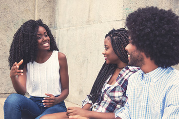 Beautiful african american woman talking with couple from Africa