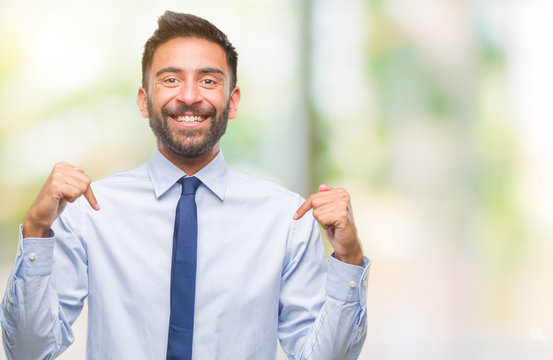 Adult hispanic business man over isolated background looking confident with smile on face, pointing oneself with fingers proud and happy.