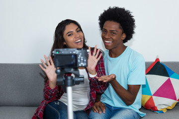 African american vlogger and influencer girl recording video blog