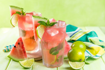 Watermelon lemonade with lime and mint, wood background, copy space