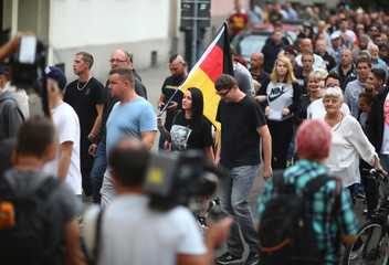 Protests after police detained two Afghans on suspicion of killing man in east Germany