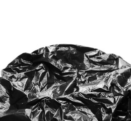 Crumpled, black plastic bag, isolated on white background, design elements, side view