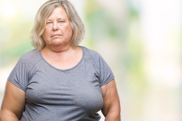 Senior plus size caucasian woman over isolated background depressed and worry for distress, crying angry and afraid. Sad expression.