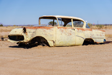 old white car in desert rotten