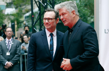 Actors Christian Slater and Alec Baldwin pose at the world premiere of The Public at the Toronto International Film Festival (TIFF) in Toronto