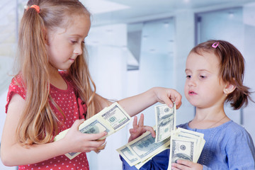 Portrait of two business children with US Dollars as symbol of bribe in an envelope.