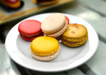 sweet macarons on white plate