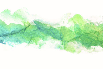 green yellow overflow of flowers watercolor stain, drawn by brush on paper on crumpled paper with streaks