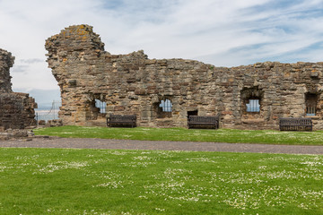 Old wall and ruin of medieval castle near North Sea in St Andrews, Scotland