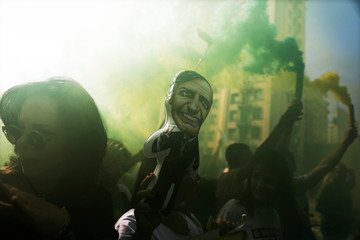 A supporter holds up a doll with the image of presidential candidate Jair Bolsonaro at Paulista Avenue, after Bolsonaro was stabbed in Juiz de Fora, in Sao Paulo