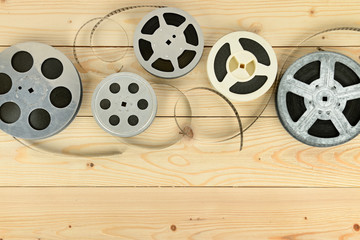 Obsolete cinema films on wooden surface of table. Wall mural