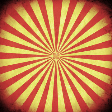 A square box with red and yellow stripes converging and forming a circle. Aged old retro vintage texture.