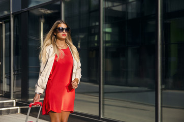Beautiful business style woman with luggage
