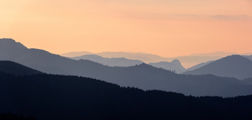 Foggy Sunrise in the Mountains. Mountain panoramic landscape.