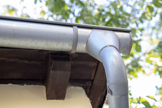 Gutter draining rainwater. The building is equipped with drainage of rainwater from the roof.