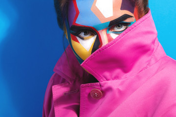 Model with a creative pop art make-up on her face