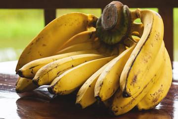 Natural organic bananas on wooden table
