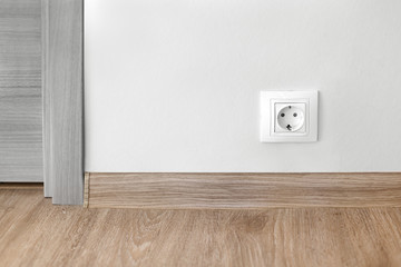 Electric socket mounted on wall at modern flat