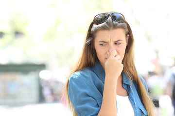 Girl covering nose in a contaminated city