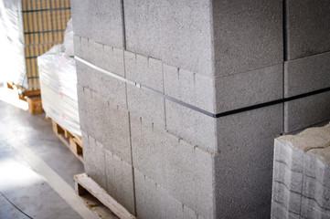 Pallet of concrete blocks industrial design building materials textured background. Build work storage unit.