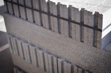 Pallet of concrete blocks tiles industrial design building materials textured background. Build work storage unit.