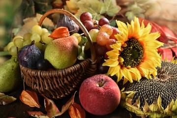 wicker basket full of autumn fruits