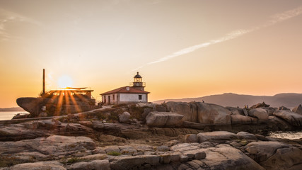 Lighthouse on the island of Arousa at sunset in Galicia, Spain