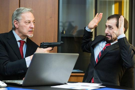 Man threatening a colleague with his gun
