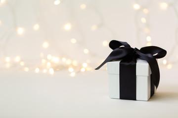 A gift box on a shiny light background