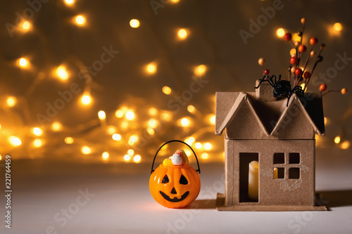 Halloween pumpkin with spider on a shiny light background