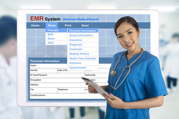 Wall Mural - Female doctor with tablet showing electronic medical record system on screen behind.