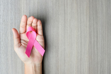 Breast Cancer Awareness, Woman hand holding Pink Ribbon for supporting people living and illness. Women Healthcare and World cancer day concept