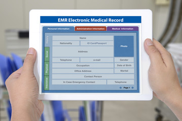Wall Mural - Electronic medical record application on digital tablet screen in hands.