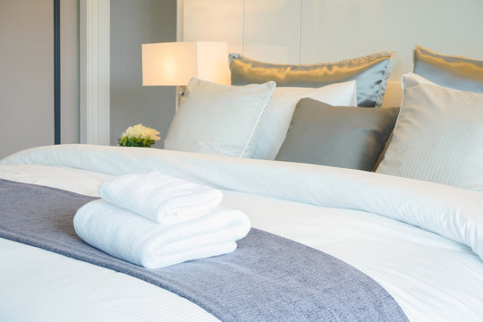 Clean towel on bed in modern interior bedroom