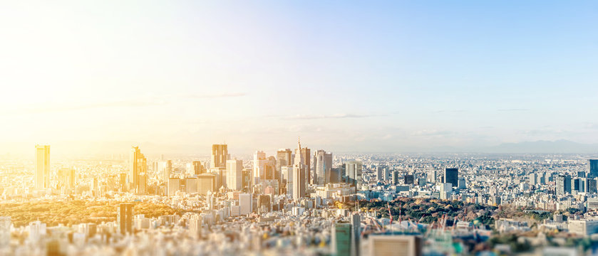 Business and culture concept - panoramic modern city skyline bird eye aerial view under dramatic blue sky in Tokyo, Japan. miniature lens tilt shift blur effect