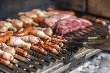 Cooking red meat, chicken and sausages for a good barbecue with friends during National Holidays at Santiago de Chile