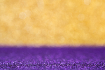 Abstract gold and luxry purple sparkling bokeh wall and floor background studio.luxury holiday backdrop mock up for display of product.holiday festive greeting card.