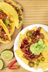Overhead photo of Mexican tacos and nachos with copy space