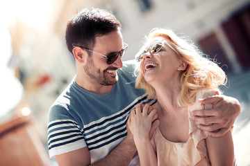 Portrait of beautiful young couple outside