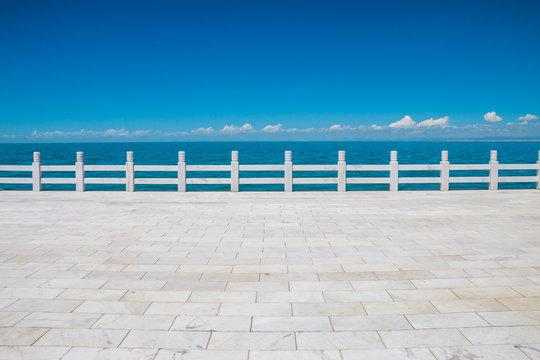 Sidewalk ground and Qinghai Lake, China